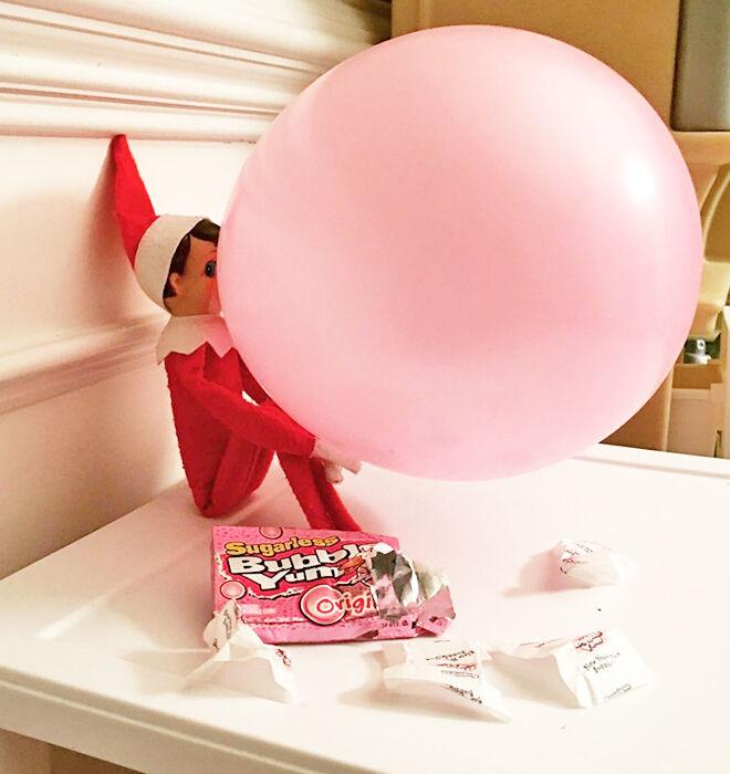 Bubblegum blowing Elf on the Shelf