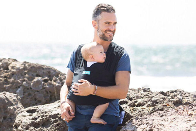 dad babywearing with Moby baby carrier