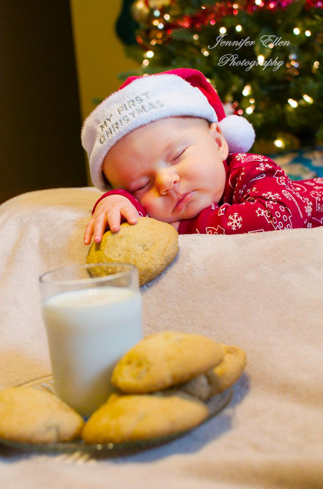 babys first christmas photo eating all the cookies