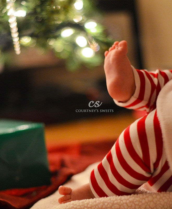 Baby's first Christmas photo ideas - dressed in red and white stockings