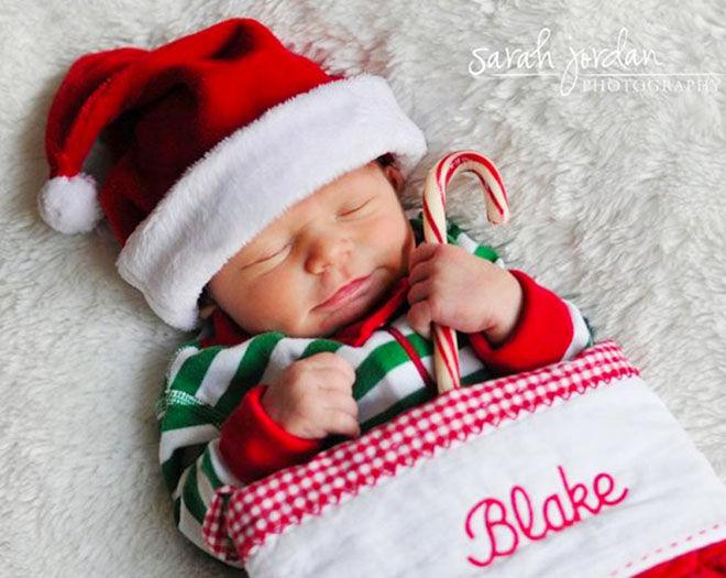 Baby's first Christmas photo, newborn baby in stocking