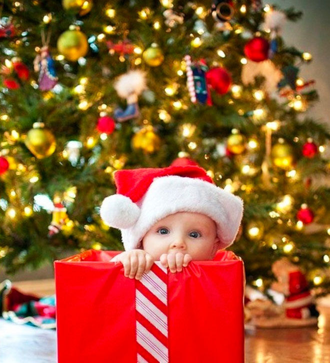 Baby's first Christmas photo, adorable gift in a box