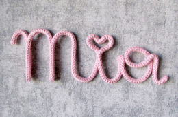 Knitted name signs for nursery walls