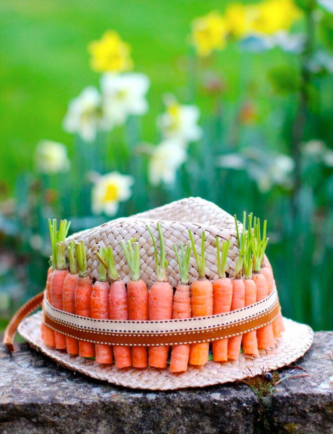 Easy Easter bonnet idea using straw hat and carrots