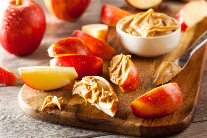 apple slices with almond butter is a quick and healthy post-pregnancy snack