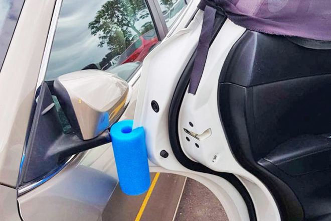 Using a pool noodle as a car door protector