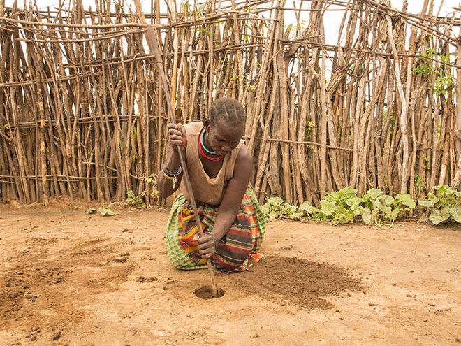 Digging hole for periods in Uganda