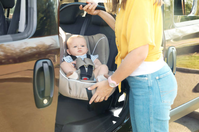 Mums are being warned of the health risks involved when carrying baby car seats