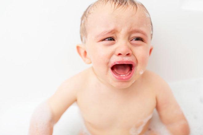 Unhappy baby in bath