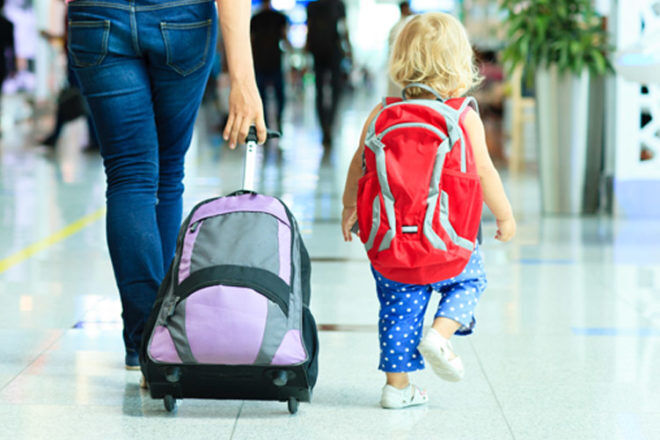 Flying with baby checked in luggage