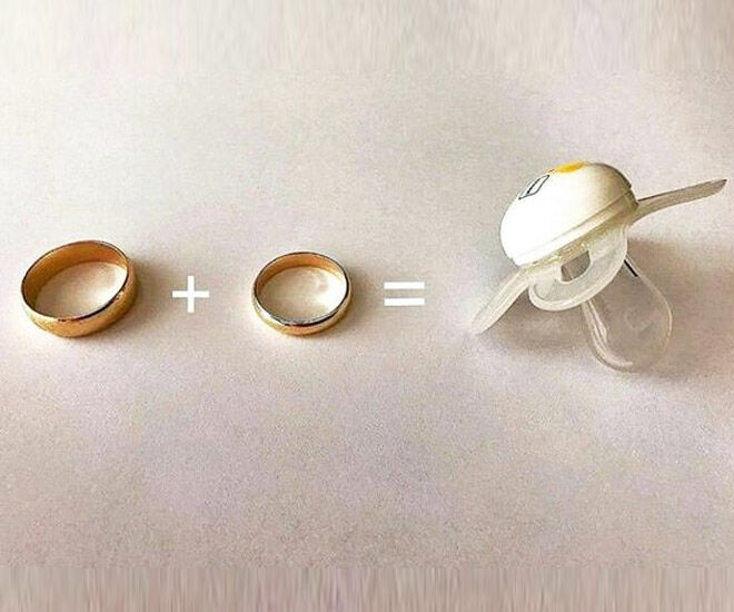 Dummy and wedding rings pregnancy announcement