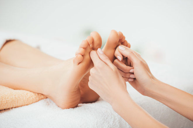 Have a foot massage to help bring on labour