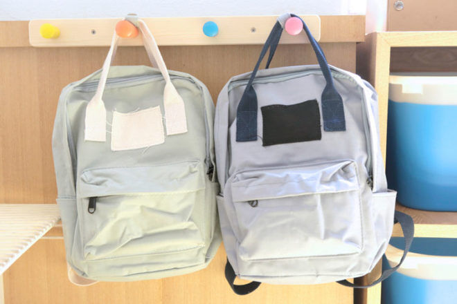 School bags hanging on hooks