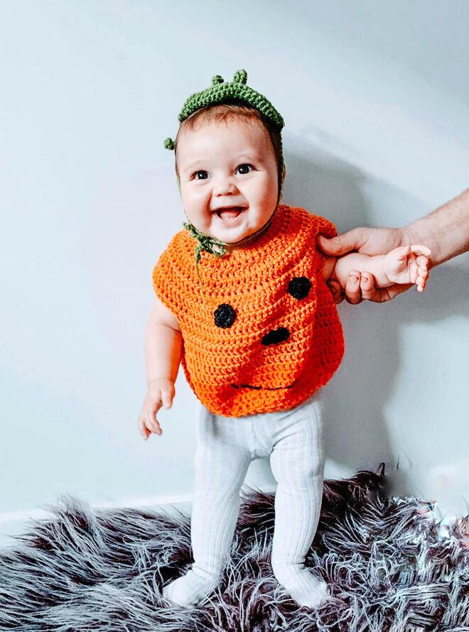 Crocheted pumpkin toddler costume