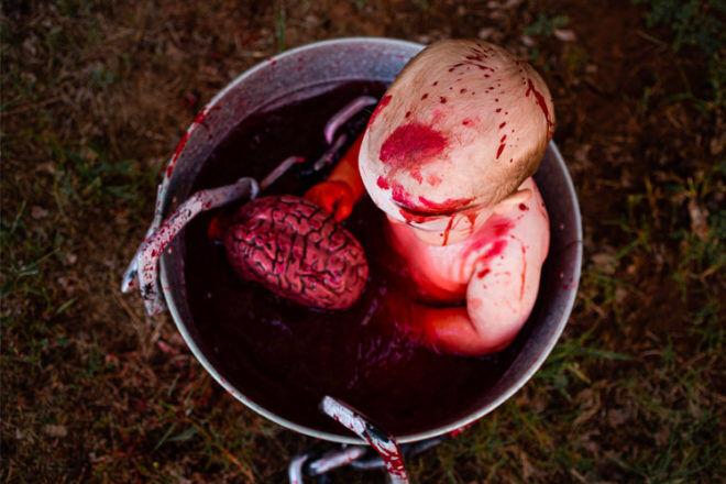 Zombie baby eating brains Halloween photos
