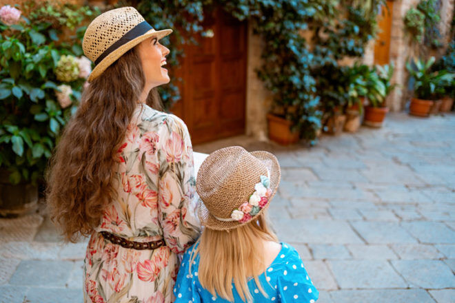 Mother and daughter exploring an old town