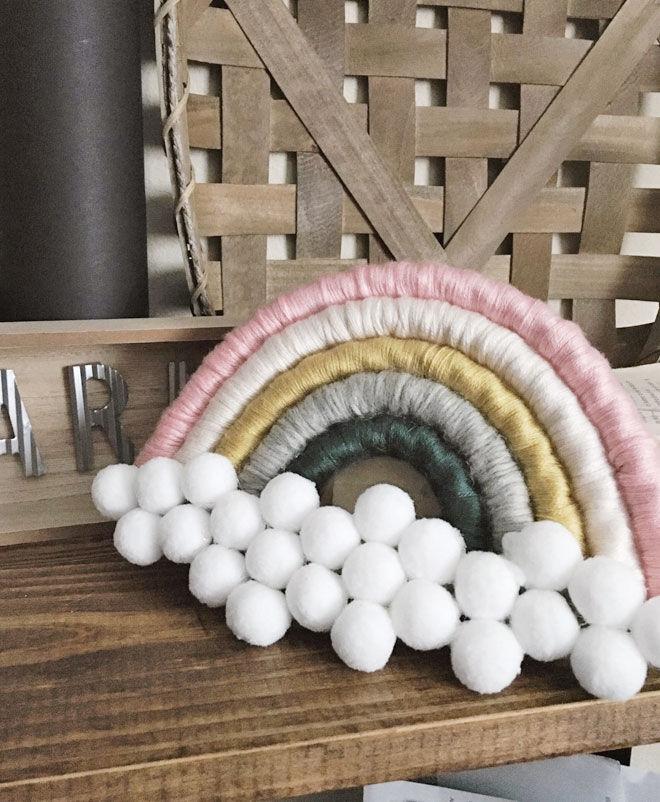 Pom pom and rope rainbow wall hanging