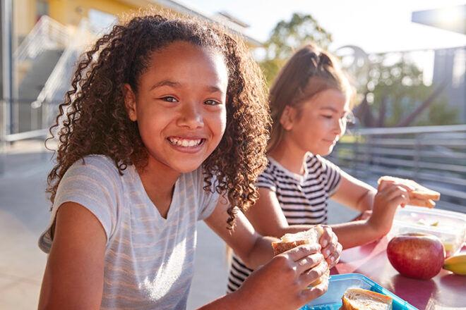 Girl eating sandwich school lunch